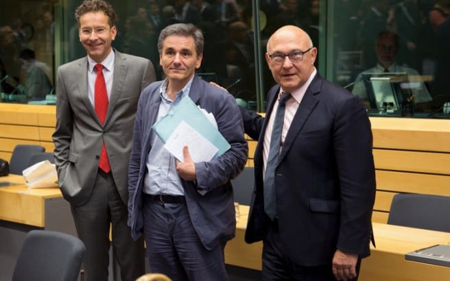 Newly appointed Greek Finance Minister Euclid Tsakalotos (C) is welcomed by Eurogroup President Jeroen Dijsselbloem (L) and French Finance Minister Michel Sapin at a euro zone finance ministers meeting on the situation in Greece in Brussels, Belgium, July 7, 2015.Greece faces a last chance to stay in the euro zone on Tuesday when Prime Minister Alexis Tsipras puts proposals to an emergency euro zone summit after Greek voters resoundingly rejected the austerity terms of a defunct bailout. REUTERS/Philippe Wojazer