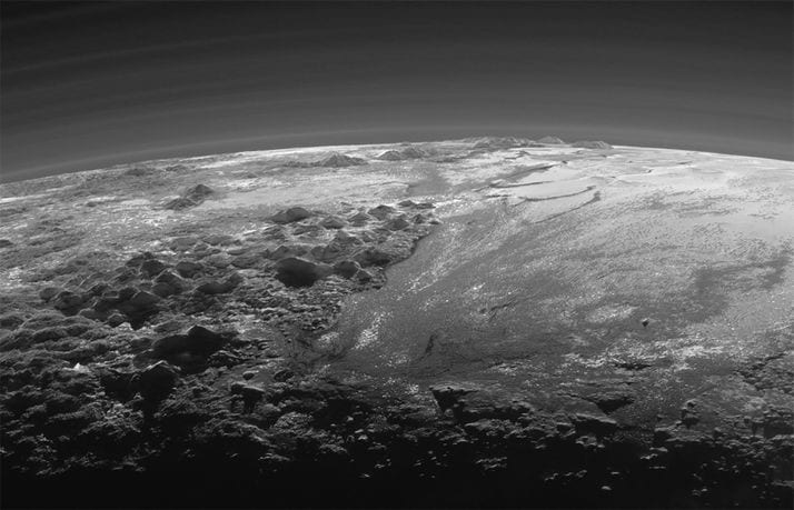 A close-up view of the rugged, icy mountains and flat ice plains on Pluto is seen in an image from NASA's New Horizons spacecraft taken July 14, 2015 and released September 17, 2015. The expanse of the informally named icy plain Sputnik Planum (R) is flanked to the west (L) by rugged mountains up to 11,000 feet (3,500 meters) high. The image was taken from a distance of 11,000 miles (18,000 kilometers) to Pluto.  REUTERS/NASA/JHUAPL/SwRI/Handout via Reuters
