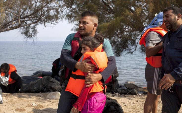 """A Syrian refugee hugs his daughter moments after arriving on the Greek island of Lesbos September 3, 2015. The International Organization for Migration (IOM) says 1,500-2,000 are taking the route through Greece, Macedonia and Serbia to Hungary every day and that there is """"a real possibility"""" the flow could rise to 3,000 daily. REUTERS/Dimitris Michalakis"""