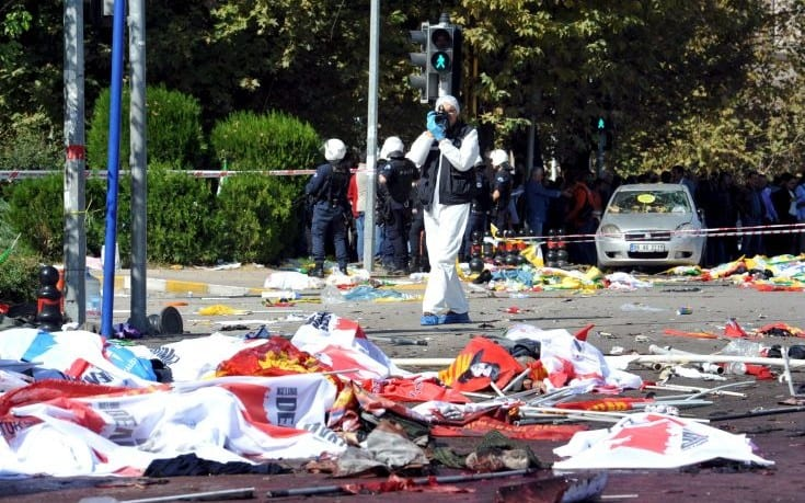 ATTENTION EDITORS - VISUAL COVERAGE OF SCENES OF INJURY OR DEATHA police forensic expert takes pictures as he examines the scene following explosions during a peace march in Ankara, Turkey, October 10, 2015. At least 30 people were killed when twin explosions hit a rally of hundreds of pro-Kurdish and leftist activists outside Ankara's main train station on Saturday in what the government described as a terrorist attack, weeks ahead of an election. REUTERS/Stringer