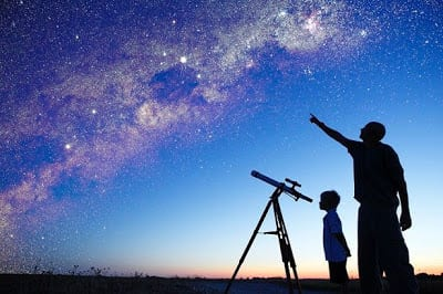 Amateur-astronomer-training-his-son