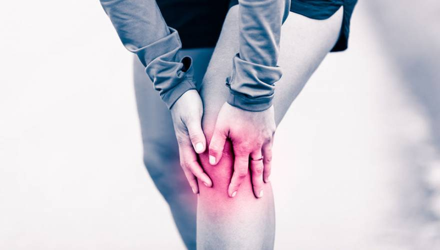 bigstock-knee-pain-woman-holding-sore-107859290